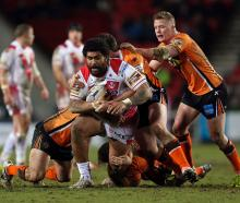 Mose Masoe (with ball) has been discharged from hospital following a spinal injury in order to...