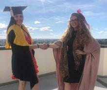 HARD WORK: Harriet Burke (left) received her Master in Teaching and Learning this week from UC ...