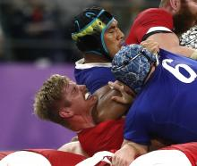 France's Sebastien Vahaamahina hits Wales' Aaron Wainwright with his elbow, turning the match....