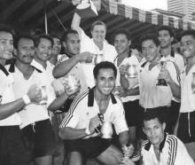 Manager Marina Schaafhausen holds winning Cup as Moata'a celebrate victory at Singapore Sevens....