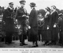 Edward, Prince of Wales, chats with returned nurses at the military review in Hagley Park,...