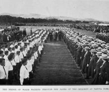 Edward, Prince of Wales walks through the ranks of children at Tahuna Park. — Otago Witness, 25.5...