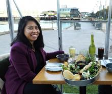 People in glass houses ... Victoria Atienza (left) and Aleen Barcos prepare to devour the first...