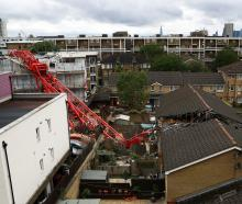 A collapsed crane is seen at a construction site in Bow, east London. Photo: Reuters
