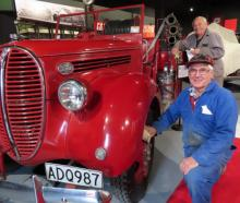 Ian Moore (front) and Bill Hart prepare the Ford V8 fire truck for ceremonial duty on Saturday at...