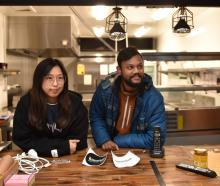 Judy Ling and Nareej Kumar Mothuku  stand at the bar of  Burger N Beast restaurant, set to open...