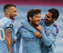 David Silva (centre) celebrates his goal this morning against Newcastle. Photo: Getty Images