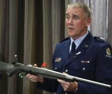 Senior Sergeant Paddy Hannon with a bolt-action rifle that will remain legal, providing the...