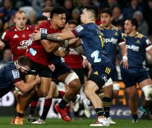The Crusaders dominated the ball, forcing the Highlanders to make 78 more tackles. Photo: Getty...