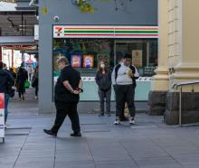 People line up outside a Covid-19 screening clinic in the inner city Melbourne suburb of Prahran....