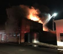 Fire engulfs a building on Rankeilor St in South Dunedin. Photo: Gregor Richardson