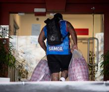 Those getting off the van could be seen carrying many bags as luggage. Photo: Dean Purcell / NZH