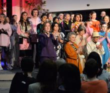 Models show off outfits designed by iD International Emerging Design Award finalists at the...