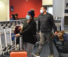 Passengers leave Dunedin Airport after arriving on a Jetstar flight from Auckland yesterday....