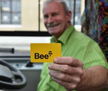 Go Bus driver Alan Savell shows off the new Bee Card in Dunedin's bus hub, in Great King St,...