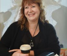 Dunedin South MP Clare Curran with phone, files, paper and coffee. PHOTO: PETER MCINTOSH
