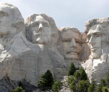 The busts of US presidents George Washington, Thomas Jefferson, Theodore Roosevelt and Abraham...