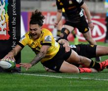 Peter Umaga-Jensen scored two tries for the Hurricanes in Wellington on Saturday night. Photo:...