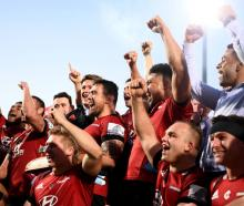 The Crusaders celebrate after clinching the Super Rugby Aotearoa title against the Highlanders in...