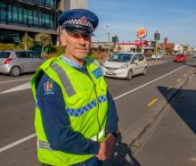 Senior Constable Clay Penrose checking up on seatbelts and cellphone use at the wheel on Lincoln...