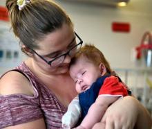 Daxton gets a cuddle from his mum Eden Anderton. Photo: NZ Herald