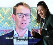 Columba College year 13 pupil Hannah Clarke  displays a video message sent to her school from...