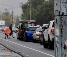 =Woodend School road patrol student Ashley Kerr, aged 11, helping control traffic near Woodend...