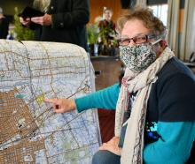 Spring Eco Fest co-organiser Jenny Campbell points to a map of community nurseries and gardens in...