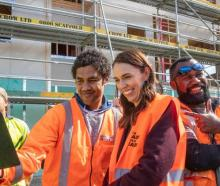 Prime Minister Jacinda Ardern poses for selfies with tradesmen at Isles Construction in...