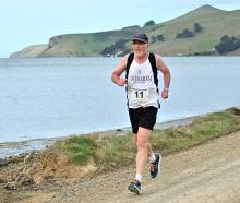 Caversham Harriers runner Ken Fahey runs around Papanui Inlet in leg five of the Peninsula Relay...