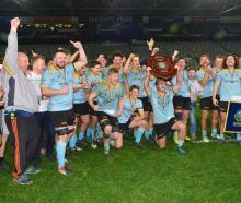 University celebrate their dramatic victory over Taieri at Forsyth Barr Stadium tonight. Photo:...