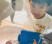 Nio Sevilla with his little sister Estella, who has left Dunedin Hospital's neonatal intensive...