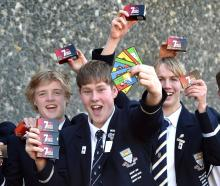 Five of the seven Otago Boys' High School pupils who created a Maori card game that has hit store...