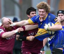 Taieri's Nick Henderson pushes his way past Alhambra-Union defender Josh Taylor at the North...