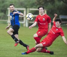 Action from Queenstown AFC vs Caversham AFC. Photo: Adam Binns