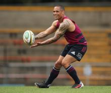 Aaron Smith gets in some handling practice during the All Blacks' captain's run at Leichhardt...