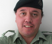 Bruce Reid impersonating a soldier in 2011. Photo: Supplied