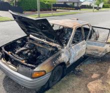 James Withington's car was pushed along the street and set alight. ​Photo: Supplied