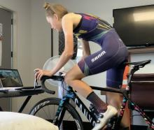 Dunedin professional cyclist Ella Harris gets in a training ride while in managed isolation in a...