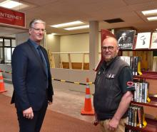 Dunedin City Council community services general manager Simon Pickford (left) ...