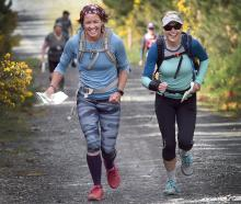 Competitors KJ Davie (left) and Cat Shaw make their way from Mt Cargill to Doctors Point during...