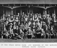 Group of soldiers with members of Otago Motor Club and Outram Bowling Club at the Outram bowls...