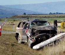The remains of a car involved in a fatal crash near Luggate on Thursday night. PHOTO: MARK PRICE ...
