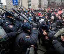 Law enforcement officers clash with protesters during a rally in Moscow on Saturday. Photo: Reuters