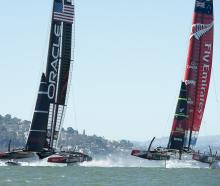 Oracle Team USA and Emirates Team New Zealand manoeuvre for starting positions in race 10 of the...