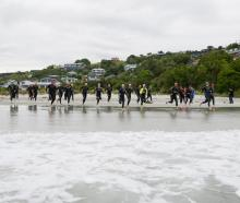 Competitors sprint for the waves at the start of the Otago Triathlon Championship at Brighton...