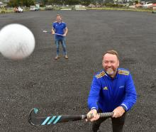 At the new hockey turf at King's High School are Otago Hockey Association pathways manager Hymie...