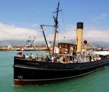 Tug Lyttelton heads into the harbour. Photo: Geoff Sloan