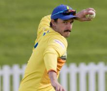 Otago top order batsman Hamish Rutherford fields the ball during a training session at the...