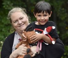 Invercargill mother Tamara Atley holds her son, George, along with Elfie and Foxie. PHOTOS: PETER...